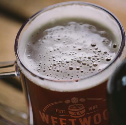 Close up of a Weetwood Ales Pint.