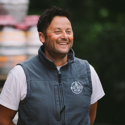 Weetwood Brewery and Distillery staff member smiling